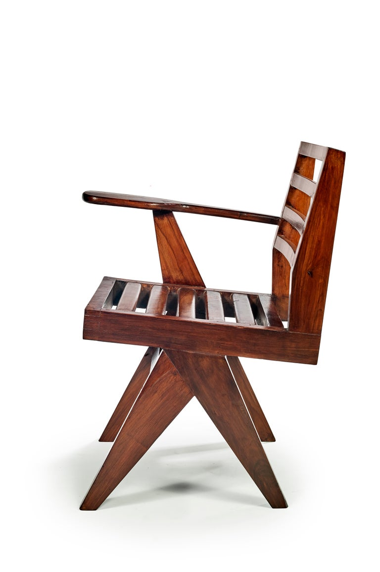 Pierre Jeanneret PJ-SI-26-G Important: Vintage collector's item for sale with guaranteed authenticity. Writing chair, circa 1960 Solid teak.  Punjab University, Chandigarh, India   Bibliography: Eric Touchaleaume et Gérald Moreau,