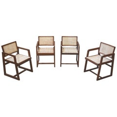 Pierre Jeanneret Rare set of 4 Cane Back Office Chairs with original Letterings