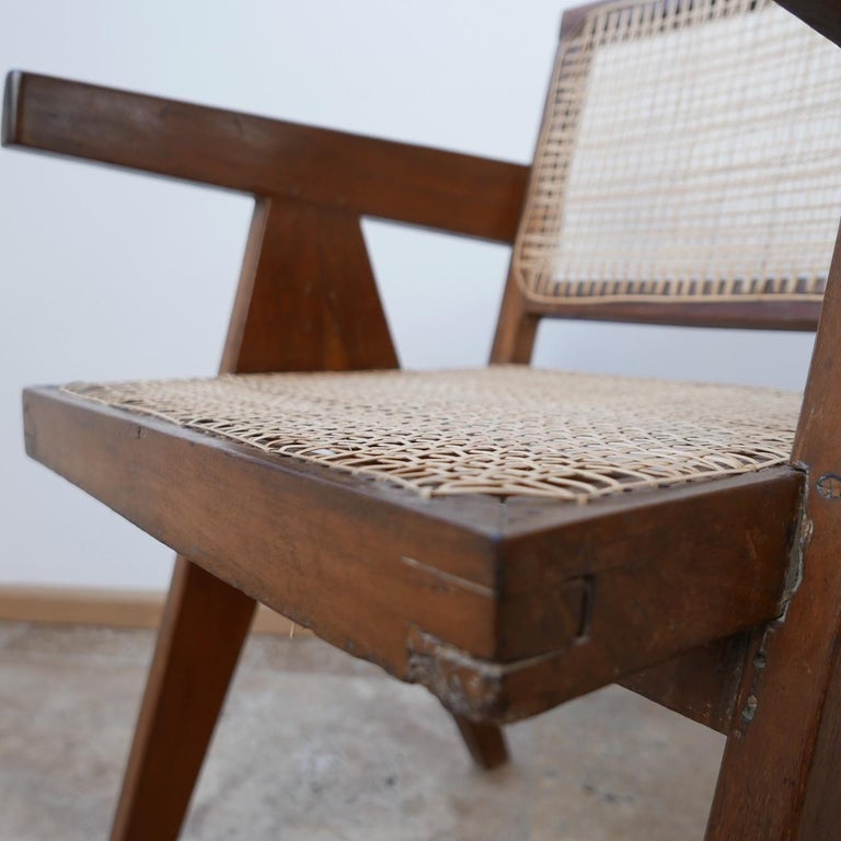 An original midcentury armchair by French design legend Pierre Jeanneret.  India, Chandigarh, circa 1956.  Cane and teak. The cane work has been replaced so it is in very good condition and sturdy.  World famous chair perfect for office,