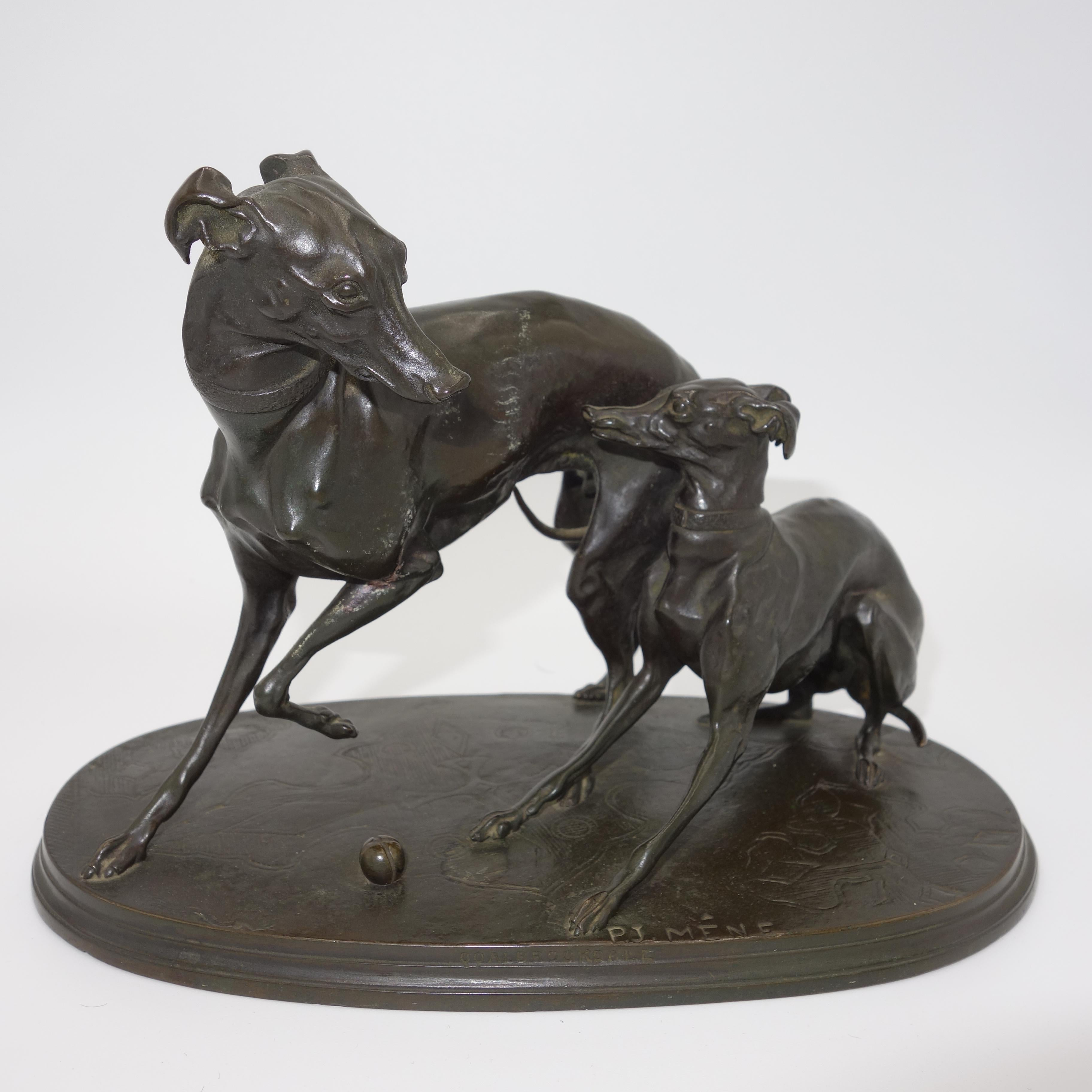 A bronze group of two whippets at play