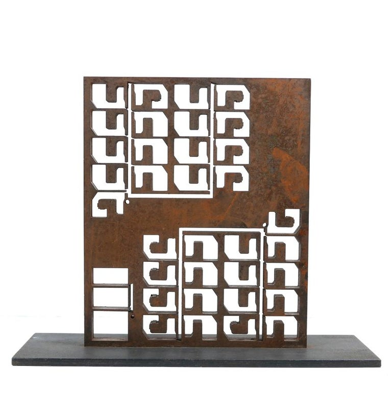 An exceptional  brutalist sculpture in raw iron .