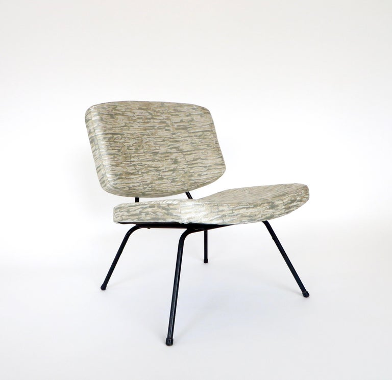 A pair of Pierre Paulin CM190 low lounge or slipper chairs designed for Thonet.  Black tubular steel structure with newly reupholstered and new cushions in a Romo machine embroidered pale blues, cream, champagne, silver wave like pattern.  An