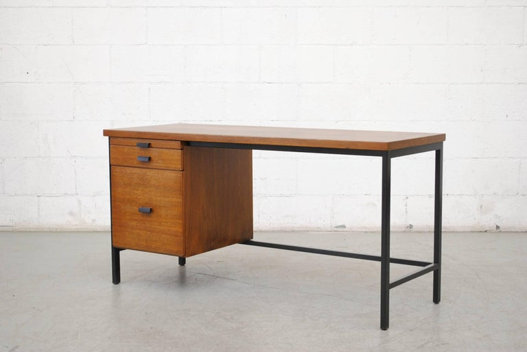 Midcentury Pierre Paulin inspired writing desk. Lightly refinished teak with black enameled metal frames and hand pulls. Super cool pullout filing cabinet drawer, organizer top drawer, and two sliding drawers. Original condition with visible wear.