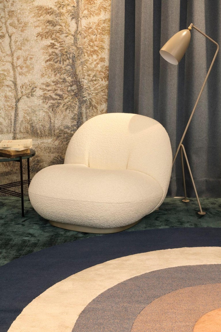 Plush, comfortable, versatile and stylish. This piece is an understated luxury. A welcoming statement lounge chair that can still the scene as easily as it can blend in a variety of style environments. Each piece is made to order. Studio and COM