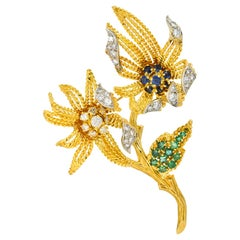 Pierre Sterlé 1960s Diamond Sapphire Emerald 18 Karat Gold Flower Brooch