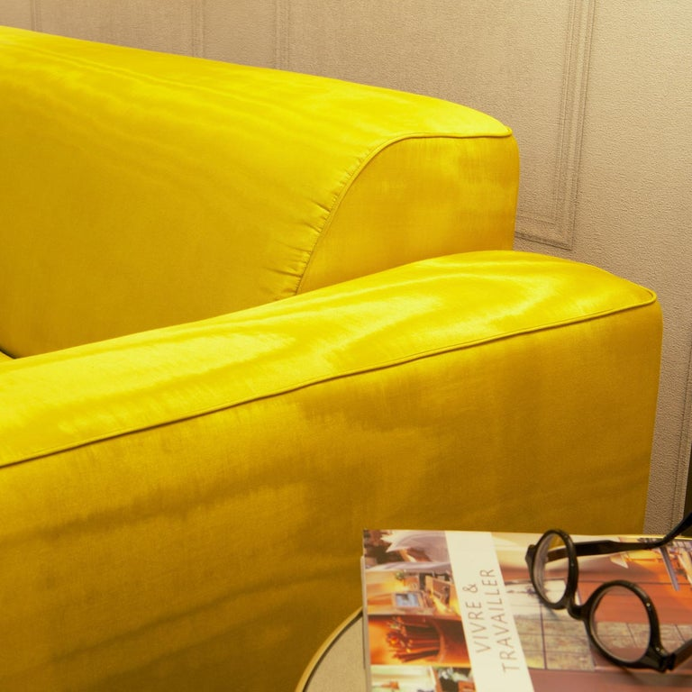 Distinctive for a textured and vibrant yellow cover this sofa will be a superb addition to an eclectic interior and a pop of lively color in a modern decor. Its clean silhouette and timeless design feature a singular cushion for the seat and