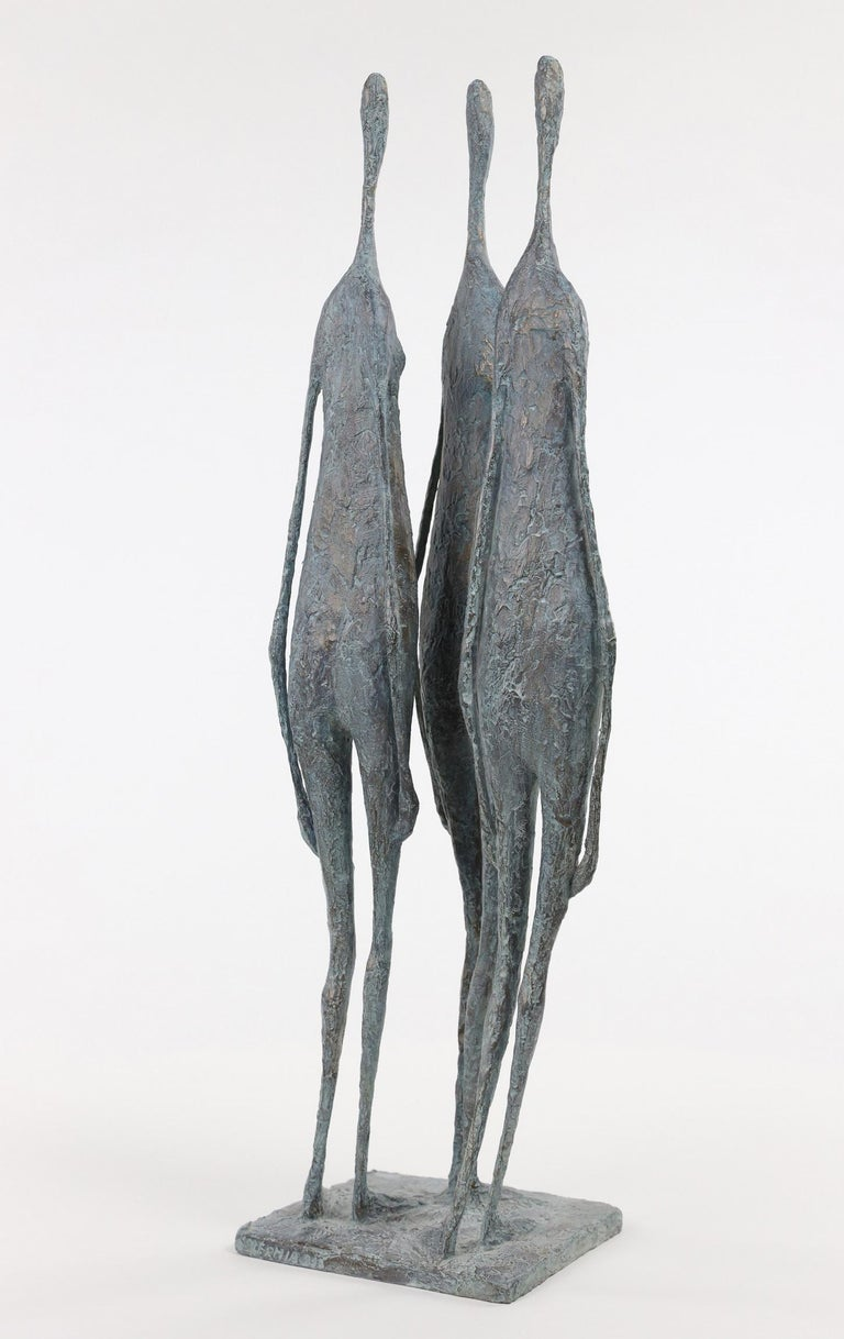 3 Standing Figures VI (3 Figures Debout VI) is a bronze sculpture by French artist Pierre Yermia.  Edition of 8 and 4 artist's proofs. Signed and numbered In this piece the sculptor is detailing the representation of the human figure placing