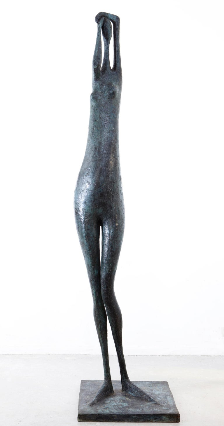 Arms Raised Monumental Standing Figure I is a large-scale sculpture by French contemporary artist Pierre Yermia. Bronze, 250 cm × 60 cm × 60 cm. Edition of 8 + 4 A.P. Each cast is signed and numbered.  Pierre Yermia has been developing for thirty