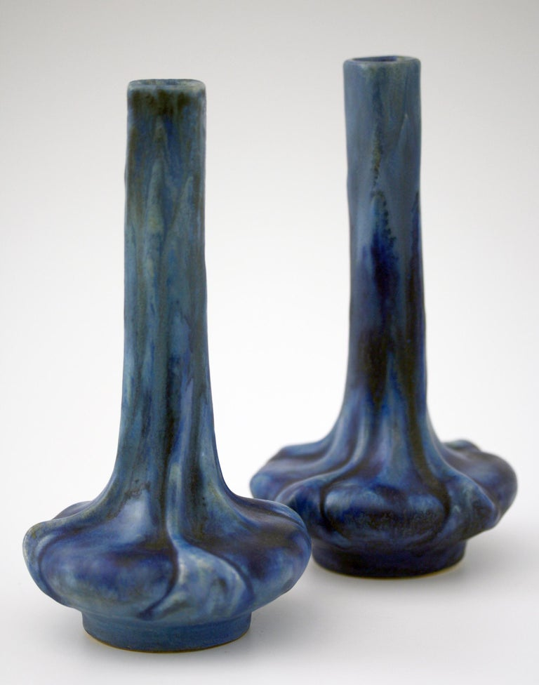 A fine pair French Art Nouveau art pottery vases decorated in blue crystalline glazes made at Olivier de Sorra's (Count Hallez d'Arros) Pierrefonds Pottery and dating from circa 1910. The vases stand on a narrow rounded foot with a moulded flower
