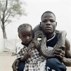 Mummy Ahmadu and a Snake Charmer with a Rock Python, Abuja, Nigeria, 2005