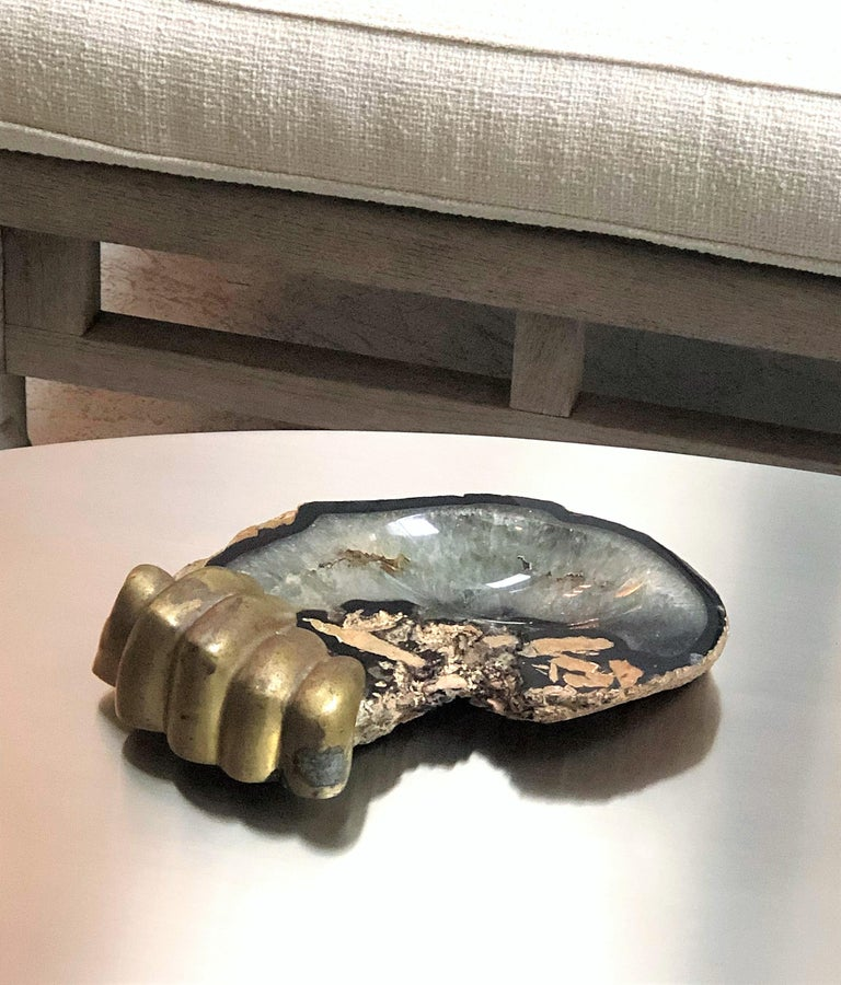 A rare vintage 1970s tray or bowl by artist Pietrina Checcacci. A larger than life-size bronze hand holds the freeform agate slab. Surrealist object by an outstanding artist.