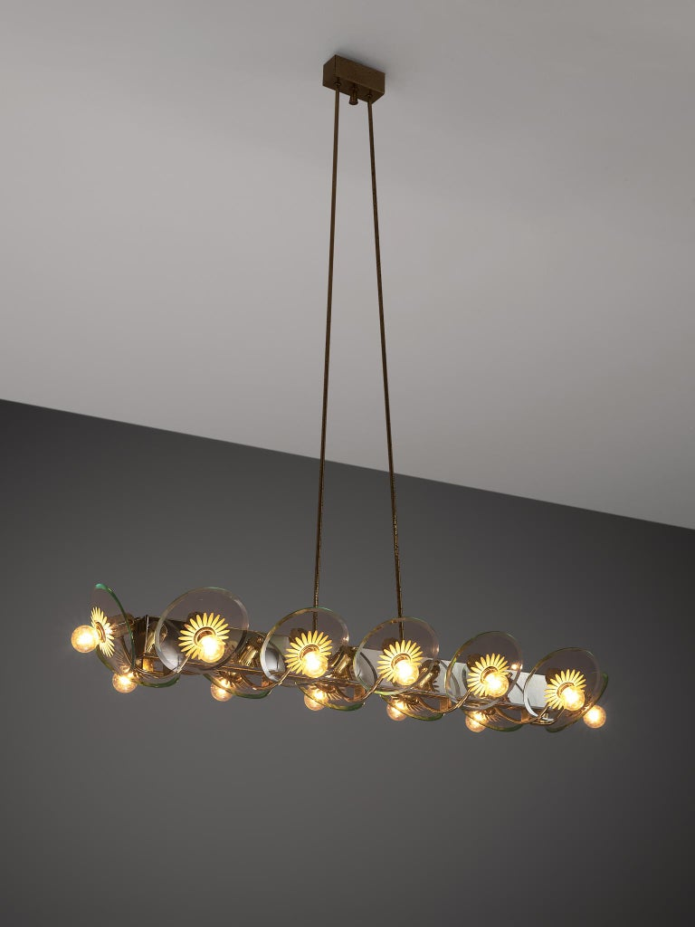 Pietro Chiesa for Fontana Arte, chandelier, brass and glass, Italy, 1940s.  This large chandelier by Italian designer Pietro Chiesa consists of twelve lights with brass and lacquered brass structure. The lights are attached to glass bowls. The