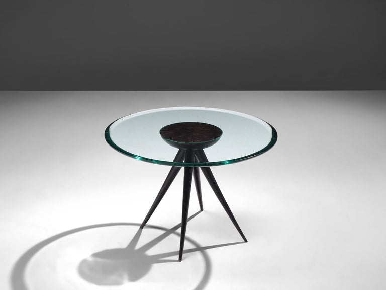 Pietro Chiesa for Fontana Arte, side table, glass and ebonized wood, Italy, 1941.  A rare side table designed by Pietro Chiesa by the premier Italian producer Fontana Arte, manufactured in 1941. The circular low table brings simplicity with