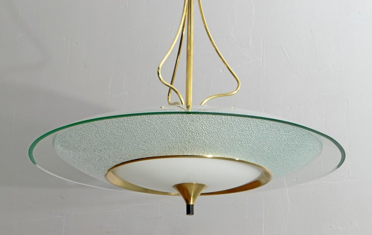 This Mid-Century glass and brass chandelier was designed by Pietro Chiesa for Fontana Arte in the 1940s.  The Italian Art Deco designer Pietro Chiesa was born in Milan in 1892 in a family of artists originally from Ticino, Switzerland. After his