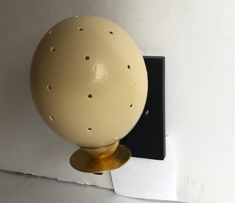The light given off by these unique sconces, with their simple clean design, is warm and intriguing. The gold leaf accents on the lights pairs nicely with the egg shells and the black enamel back plate. Perfect accent lights. The light has one