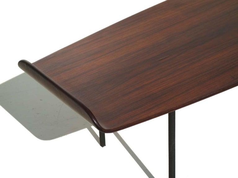 Bent plywood with teak veneer  Black embossed metal legs.