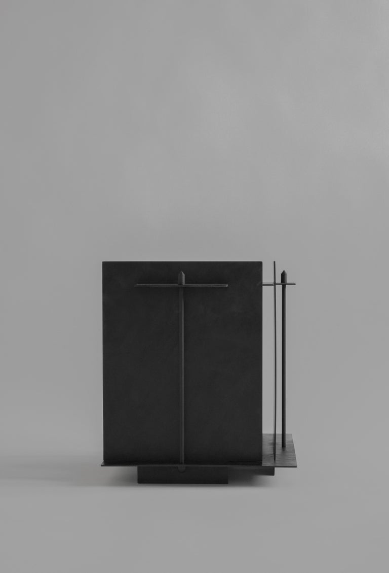 Pilier side table by Sizar Alexis Signed and Numered Edition of 12 Dimensions: Length 40 x width 34 x height 39 cm Materials: Blackened steel Weight: ~ 15kg   A series of boldly sculpted furnitures and objects, an appreciation of the raw