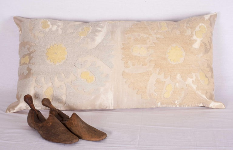 The pillow is made from a vintage Uzbek Samarkand Suzani. Cotton embroidery on a satin silk background. It does not come with an insert but comes with a bag made to the size and out of cotton to accommodate the filling. The backing is made of linen.