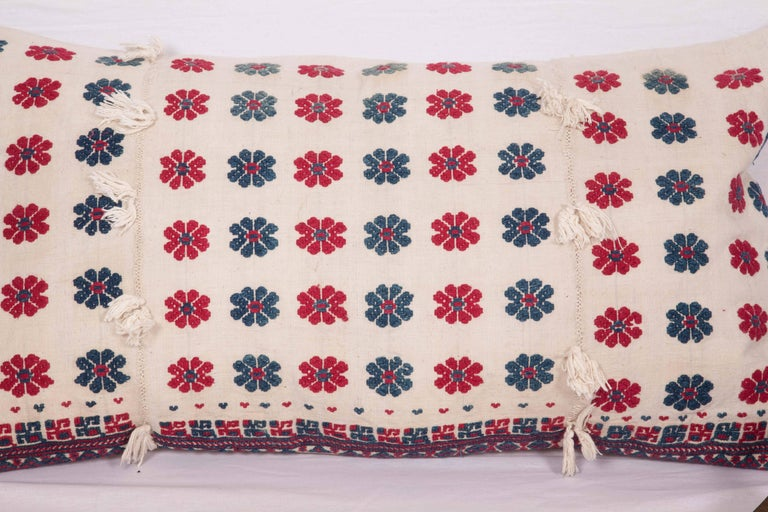 The pillow is made from an early 20th century. Western Anatolian embroidered cotton dress skirt. It does not come with an insert but it comes with a bag made to the size and out of cotton to accommodate the filling. The backing is made of linen.