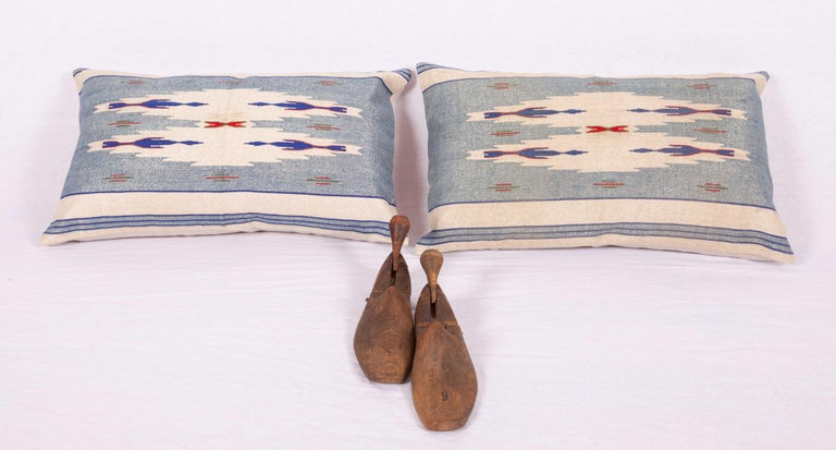 The pillows are made from an early 20th century Syrian textile. They do not come with an insert but they come with bags made to the size and from of cotton fabric to accommodate the filling. Backing is cotton canvas. Please note filling is not