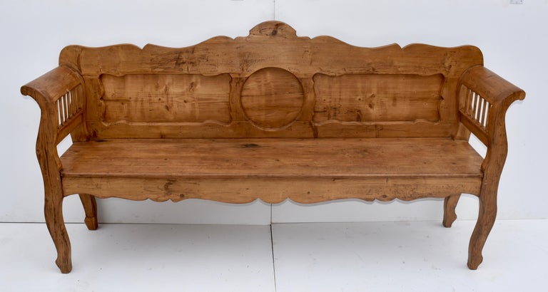 "79. 23VJL80 (8289) pine and oak bench or settle, Hungary, circa 1880, Measures: 79"" L x 21.5"" D x 37.5 H $1395.00 This is a most interesting and unusually decorative central European pine and oak bench. The back has a boldly scalloped top rail with"