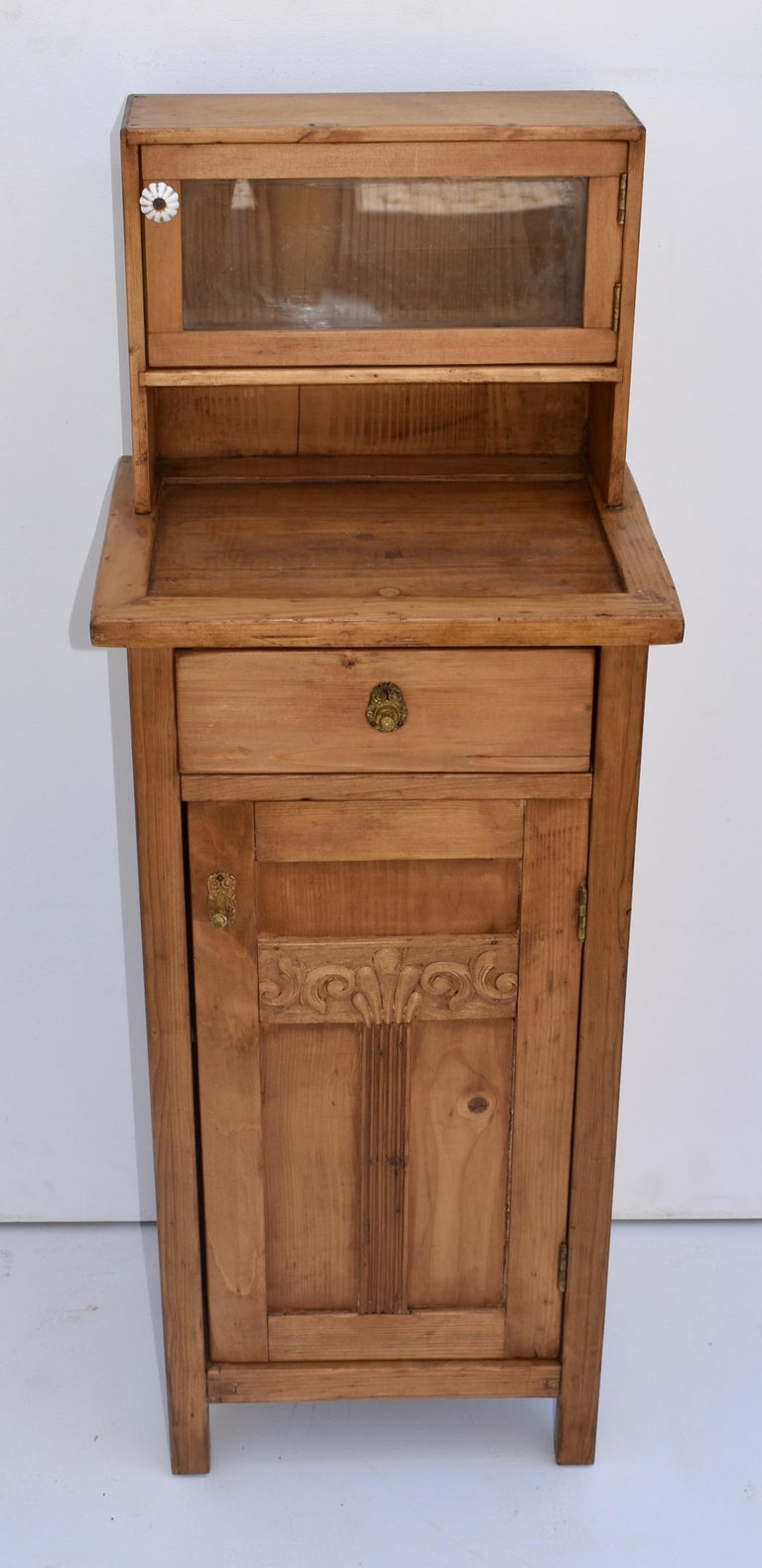 This single nightstand has the usual configuration of one door and one drawer but also has a 12