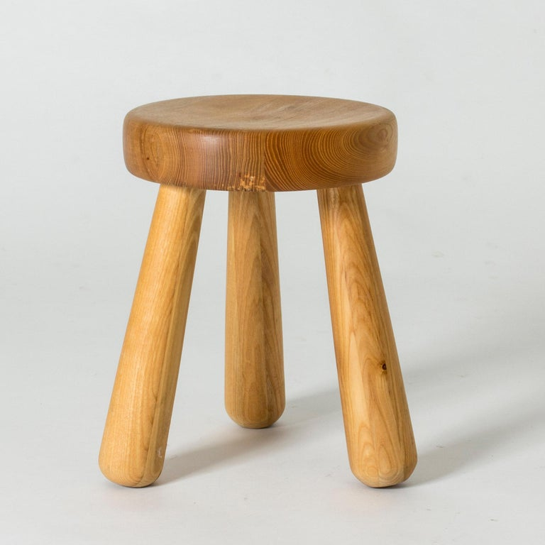 Chunky wooden stool by Ingvar Hildingsson, made from solid pine. Three legs, round seat, designed in a clean, appealing shape.