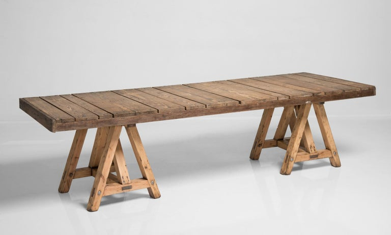 Pine trestle table, France circa 1930.  Rustic construction with plank top and substantial sawhorse legs.  Measures: 111.5