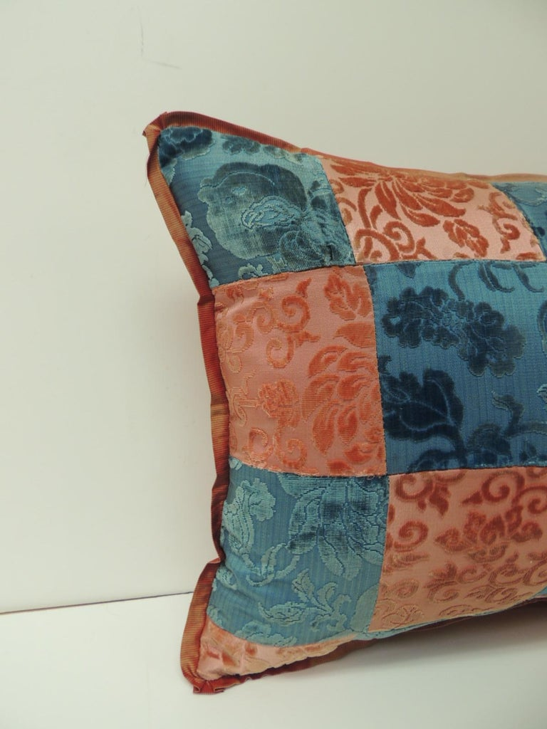 Pink and blue romance through the Gilded Age's Asian textiles patchwork bolster pillow Decorative pillows handcrafted from two Asian antique textiles combining floral silk cut velvet gaufrage in pink with chrysanthemums motifs and blue clouds. Late