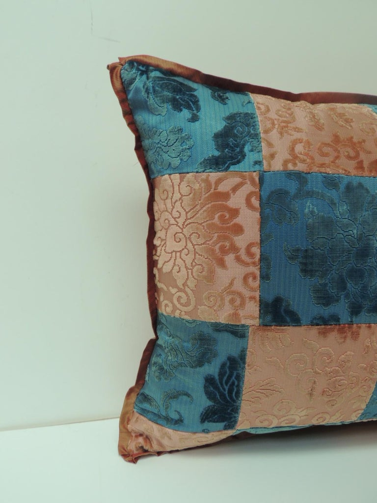 Pink and blue Romance through the Gilded Age's Asian textiles patchwork bolster pillow decorative pillow handcrafted from two Asian antique textiles combining floral silk cut velvet gaufrage in pink with chrysanthemums motifs and blue clouds. Late