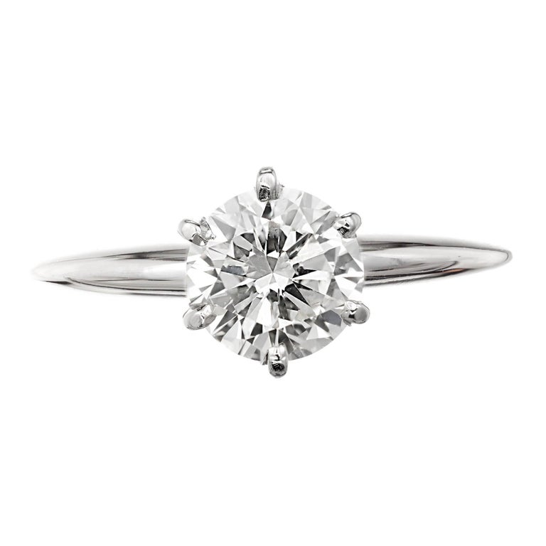 1.00ct Round Diamond 14k white gold solitaire engagement ring.  EGL certified Q-R, VS1  EGL certificate # US64065704D 1.00 Ct Q-R color, VS1 clarity, Depth: 58%, Table 61% Size 6 ¼ and sizable Width at top: 8mm Height at top: 7mm Width at bottom: