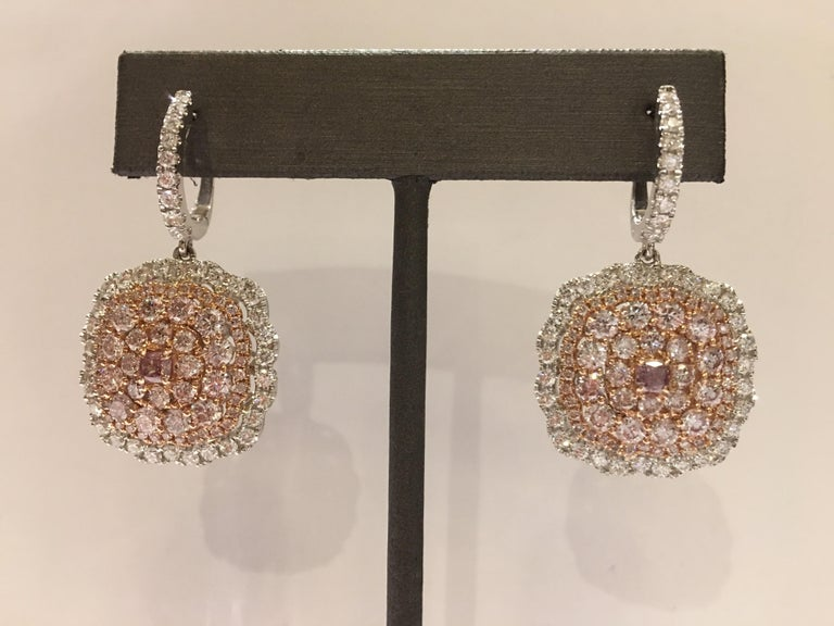 Natural Pink and White Diamonds set in 14K two tone Gold. Center two Pink is 0.39 Carat and other Pink are 3.55 Carat Diamond. Other white Diamonds are 1.93 Carat.  One of kind hand crafted Earrings, Total Diamond Weight is 5.87 Carat VS Quality