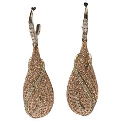 Pink and White Diamonds Set in 14 Karat Two-Tone Gold Earrings