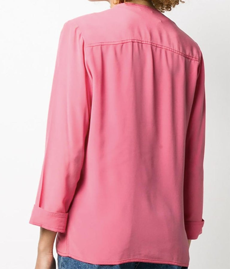 1990s pink Chanel soft silk jacket featuring a relax fit, a double-breasted fastening, no lapels,structured shoulders, turn up cuffs, a v-neck, two front pockets, no lining and cropped long sleeves.    Estimated size 38fr/US6 /UK10 Composition: 100%