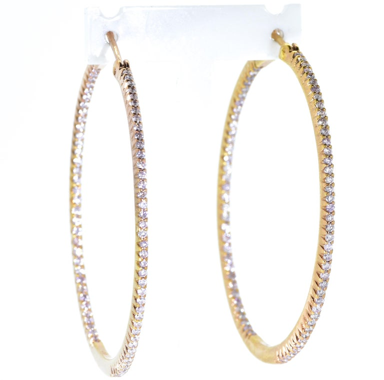 Hoop Earrings with diamonds set throughout.  There are 150 fine white diamonds, .98 cts., (a light carat), well cut and well matched, G/H (near colorless), and very slightly included (VS),  These new hoop earrings have an interior dimension of 1.5/8