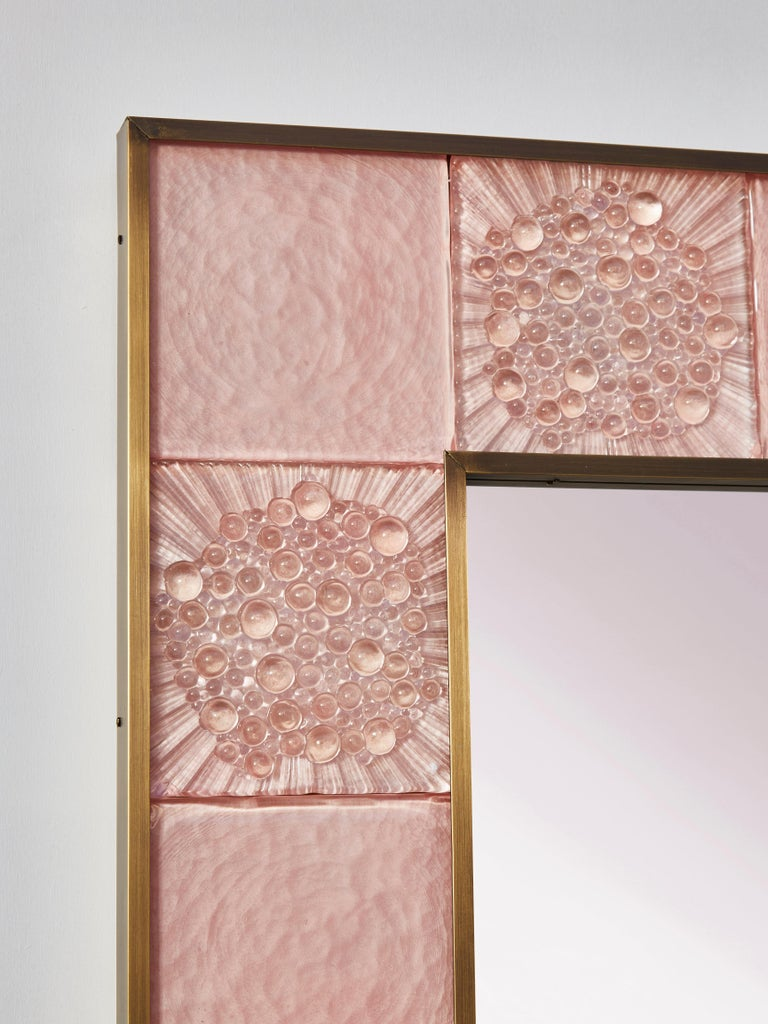 Stunning mirror with a frame in tainted and sculpted Murano glass. Creation by Studio Glustin. Pair available.