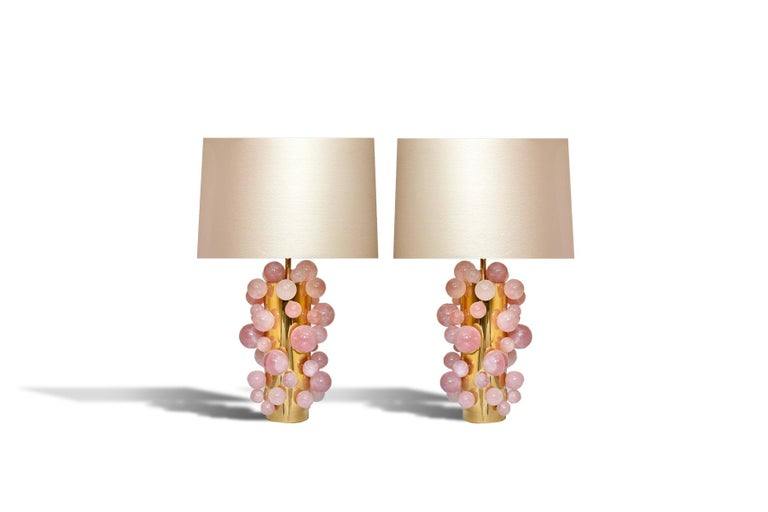Pair of natural pink rock crystal lamps with polish brass stand. Created by Phoenix to the top of the rock crystal bubble 14.5 inch.