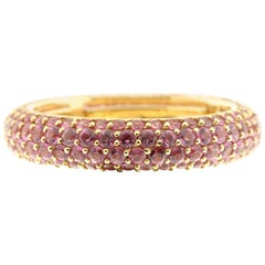 Pink Sapphire and 18 Karat Yellow Gold Eternity Ring