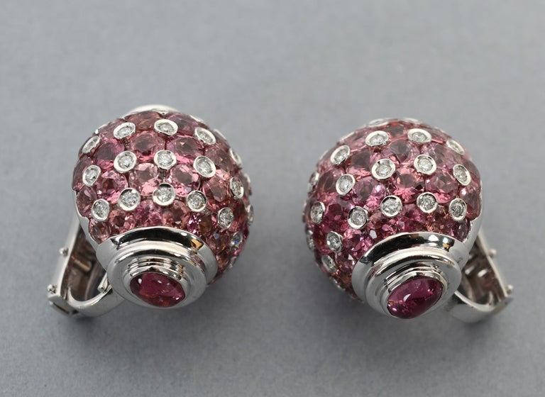Showy, but not too, too - earrings of pink sapphire; tourmaline and diamond. The body of the earrings alternate approximately 3 carats of diamonds with more than 6 carats of tourmaline. The top and bottom are oval pink sapphires. All are set in