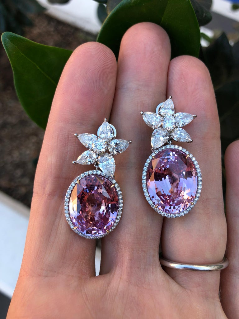 Rare and incredible oval pair of G.I.A certified 36.64 carat unheated and heated Pink Sapphire earrings, set with a total of 3.93ct pear shaped diamonds, a pair of 0.53ct total round brilliant diamonds, and 0.63ct total round brilliant melee