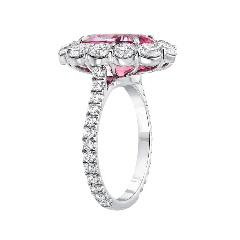 Spectacular 5.55 carat GIA certified natural unheated Ceylon Pink Sapphire oval, and 2.37 carat total diamond platinum ring. Lady Gaga engagement ring style. GIA certificate is attached. Size 6. Re-sizing is complimentary upon request. ***Returns