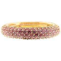 Pink Sapphire Eternity Ring in 18 Karat Yellow Gold