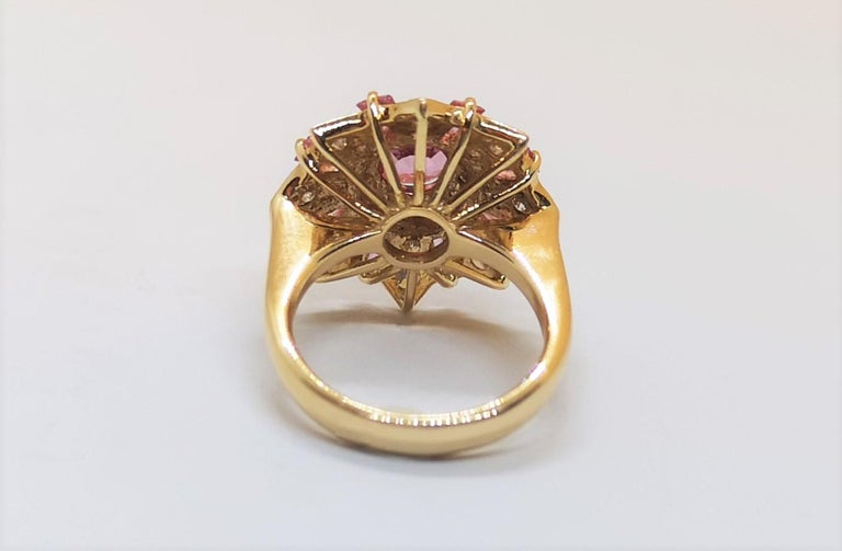 Round Cut Pink Sapphire with Diamond Ring Set in 18 Karat Rose Gold Settings For Sale