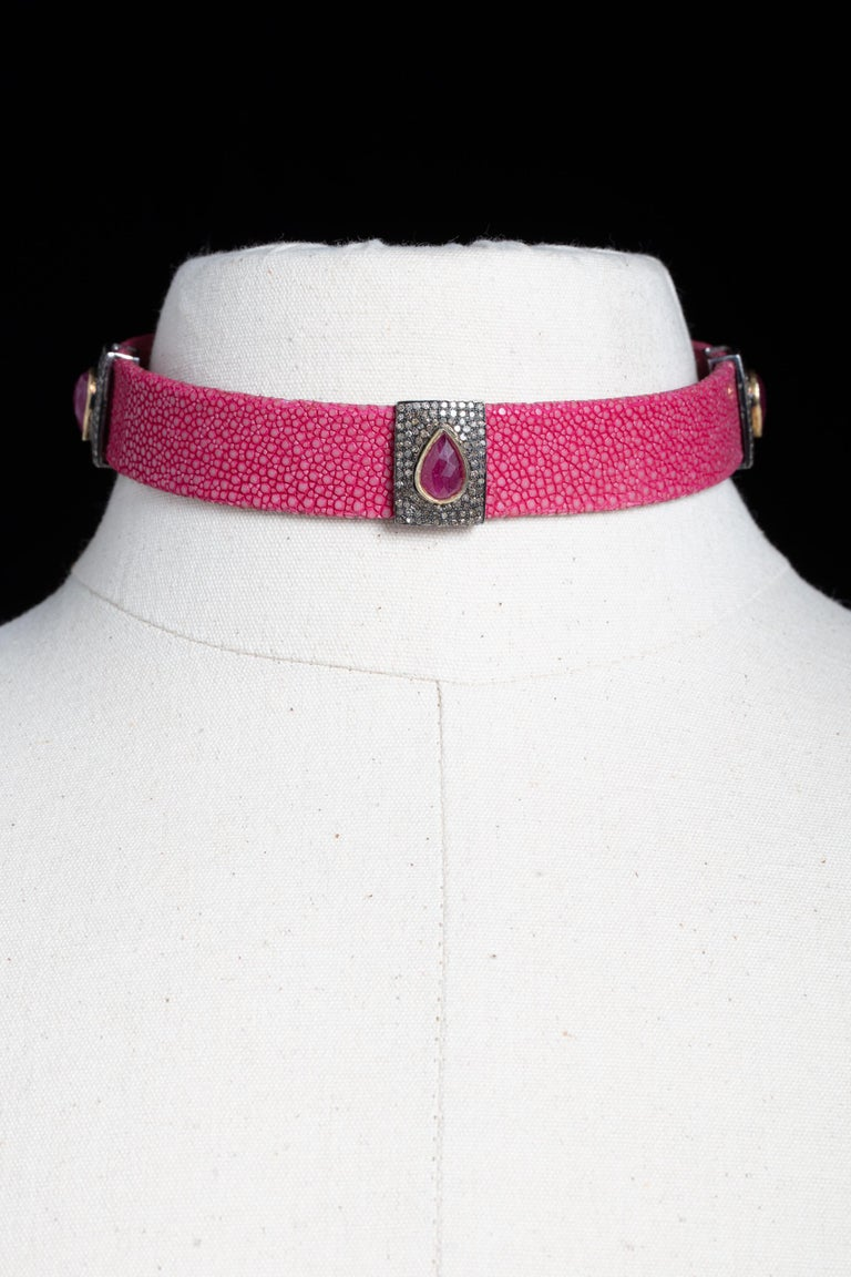 A very cool pink shagreen (sting ray) choker necklace with sterling silver buckle and three diamond and ruby slides that you can place as you please.  Rubies are pear-shaped, faceted Burmese rubies with a total of 6.8 carats.  The smallest size