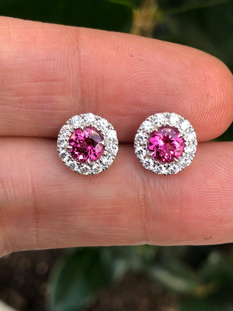 A vibrant Pink Spinel round pair, totaling 1.14 carats, are surrounded by a diamond halo totaling 0.47 carats, in these fabulous platinum, diamond earring studs for women. Returns are accepted within 7 days of delivery and will gladly be paid by us.