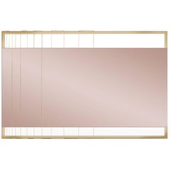 Pink Tinted Contemporary Mirror on a Gold Metal Frame with Brass Wire