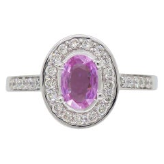Pink Topaz and Diamond Halo Ring