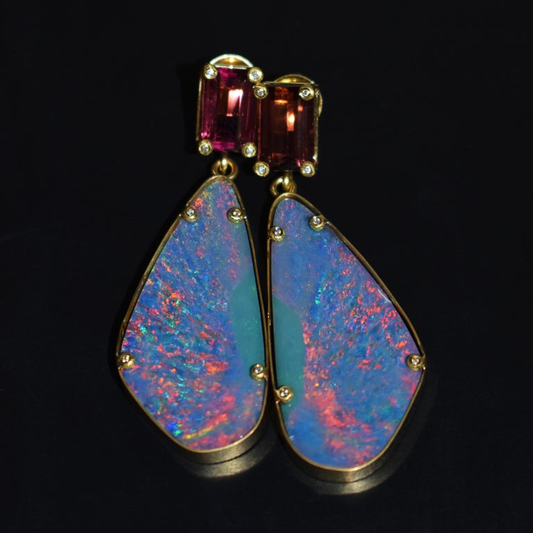 9.02 carat Pink Tourmaline and 37.6 carat Australian Boulder Opals set in hand-forged 22k yellow gold stud dangle earrings with accent white diamonds (0.08 cttw, G-H, SI1). Dangle earrings are 2.25 inches or 57mm in length. Amazing play-of-color and