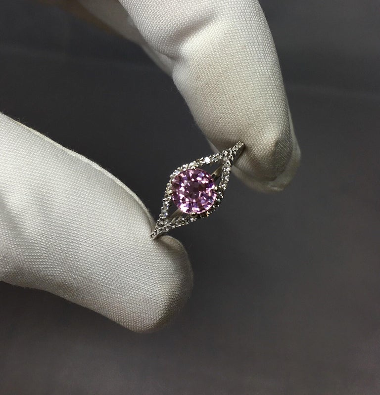 Stunning pink tourmaline set in a fine diamond studded 9k white gold ring setting.  0.90 carat tourmaline with a beautiful colour and excellent clarity. Very clean stone with only small inclusions visible when looking closely. Surrounded by 22