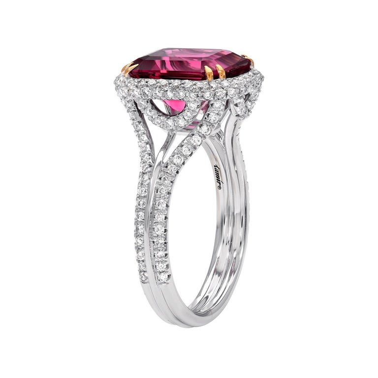 3.48 carat emerald cut reddish Pink Tourmaline (also known as Rubellite), is hand set in this fantastic 18K white gold ring, secured by 18K yellow gold prongs, and adorned by a total of 0.63 carat round brilliant diamonds. Ring size 6.5. Re-sizing